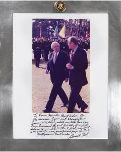 Colour photograph of the 38th POTUS with the then Prime Minister of Great Britain, walking & talking.